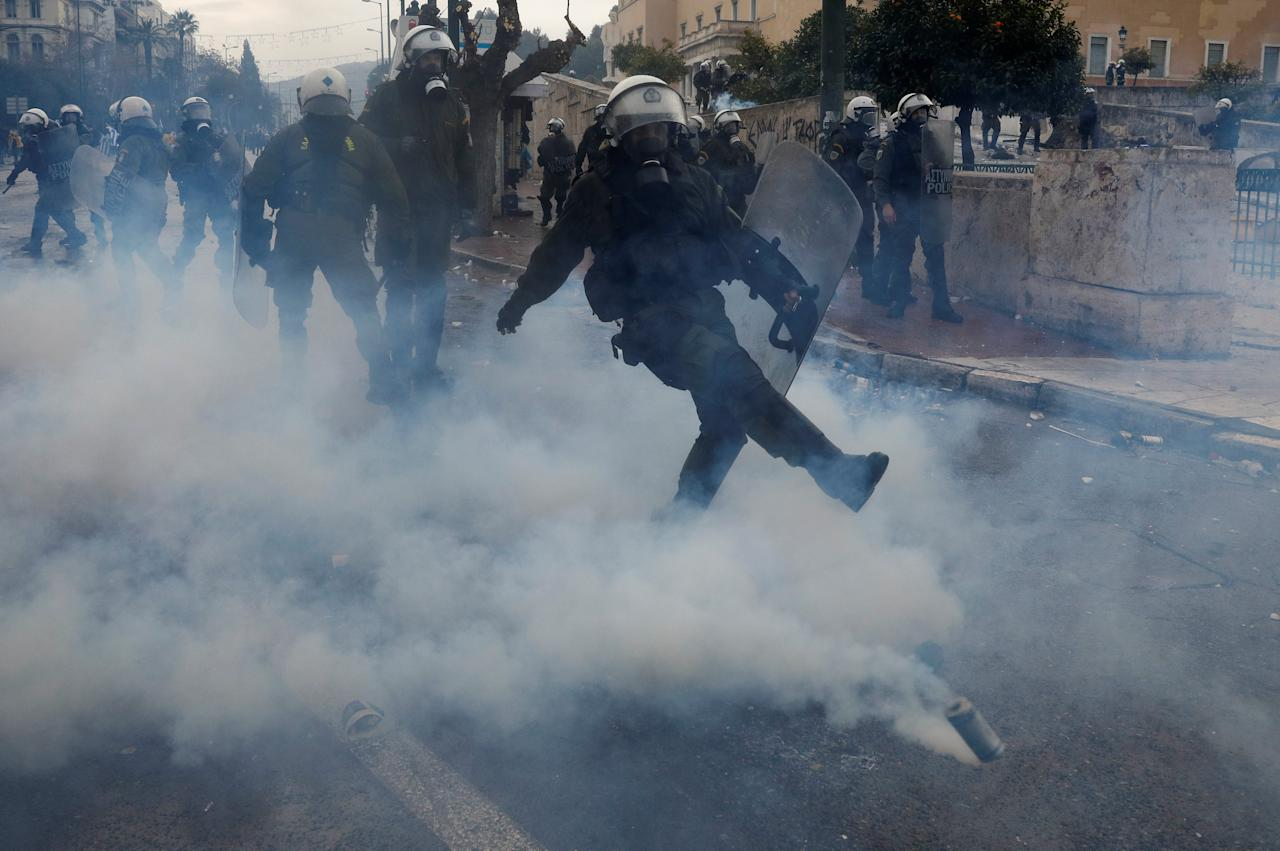 Police officers react during a demonstration against the agreement reached by Greece and Macedonia to resolve a dispute over the former Yugoslav republic's name, in Athens, Greece, January 20, 2019. REUTERS/Alkis Konstantinidis
