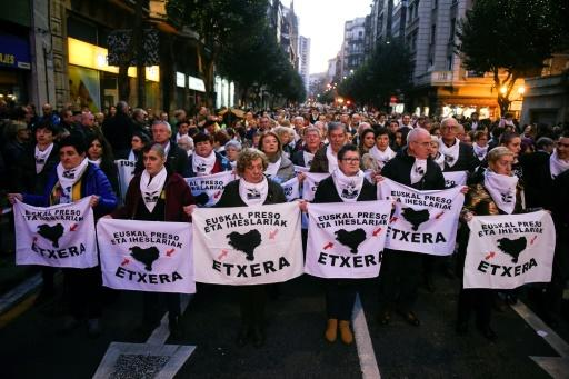 """Relatives of Basque prisoners hold banners reading """"Basques prisoners and fugitives back home"""" during a protest in the northern Spanish city of Bilbao to demand the transfer of ETA prisoners to jails near their homes"""