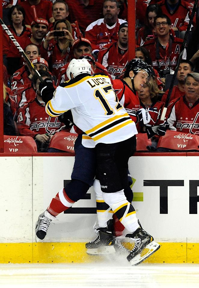 WASHINGTON, DC - APRIL 19:  John Carlson #74 of the Washington Capitals and Milan Lucic #17 of the Boston Bruins battle against the glass in Game Four of the Eastern Conference Quarterfinals during the 2012 NHL Stanley Cup Playoffs at Verizon Center on April 19, 2012 in Washington, DC.  (Photo by Patrick McDermott/Getty Images)