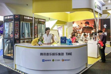 FILE PHOTO: Visitors are seen at a booth of Tencent Music Entertainment at the Beijing Music and Life Show in Beijing
