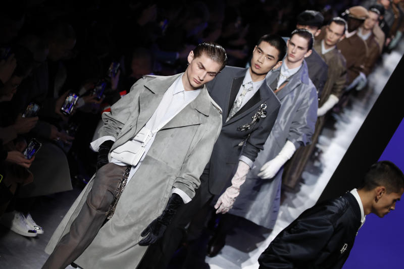 Models wear creations for the Dior Homme Mens Fall/Winter 2020-2021 fashion collection presented in Paris, Friday Jan. 17, 2020. (AP Photo/Francois Mori)
