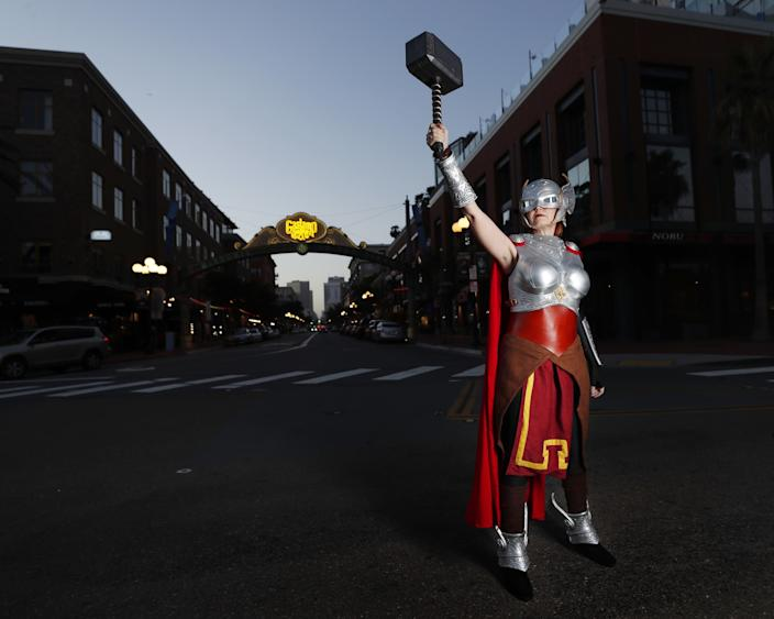 "Colleen Rodriguez, in San Diego's Gaslamp District, dressed as Marvel's Thor in an outfit made of cotton, super suede and a 3D-printed piece. She has been going to Comic-Con for six years, four of them as a vendor. <span class=""copyright"">(K.C. Alfred / The San Diego Union-Tribune)</span>"
