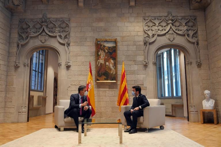 Spain's Pedro Sanchez, sitting on the left, was in Barcelona to speak with Catalonia's recently-elected regional leader Pere Aragones (AFP/LLUIS GENE)