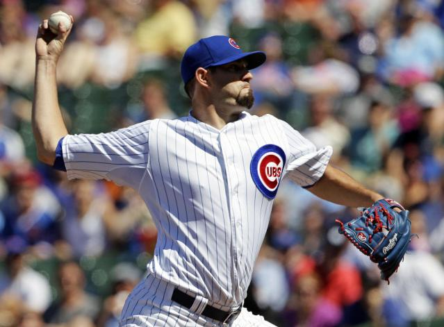 Chicago Cubs starter Jason Hammel throws against the Miami Marlins during the first inning of a baseball game in Chicago, Friday, June 6, 2014. (AP Photo/Nam Y. Huh)