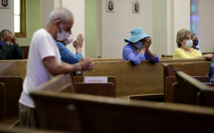 FILE - Parishioners wear face masks as they attend an in-person Mass at Christ the King Catholic Church in San Antonio, Tuesday, May 19, 2020. For the first time in nearly two decades, only half of U.S. households donated to a charity, according to a study released Tuesday, July 27, 2021. Experts say many factors are contributing to the decline. The percentage of Americans who give to religious causes has decreased in tandem with attendance at worship services as the number of Americans not affiliated with any religion grows. (AP Photo/Eric Gay, File)