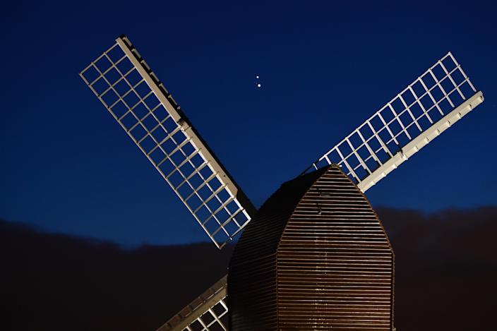 Jupiter and Saturn are seen coming together in the night sky, over the sails of Brill windmill, on December 20, 2020, in Brill, England. / Credit: Jim Dyson/Getty Images