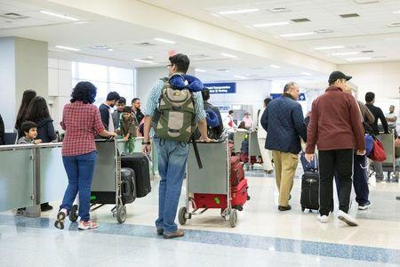 International travellers arrive at Dallas/Fort Worth International Airport in Dallas, Texas, U.S.