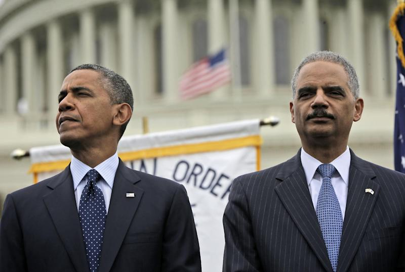 President Barack Obama and Attorney General Eric Holder attend the 32nd annual the National Peace Officers Memorial Service, Wednesday, May 15, 2013, on Capitol Hill in Washington, honoring law enforcement officers who died in the line of duty. (AP Photo/Pablo Martinez Monsivais)