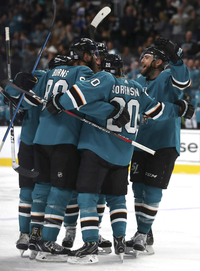 San Jose Sharks' Barclay Goodrow, right, celebrates after scoring a goal against the Minnesota Wild during the third period of an NHL hockey game Tuesday, Nov. 6, 2018, in San Jose, Calif. (AP Photo/Ben Margot)
