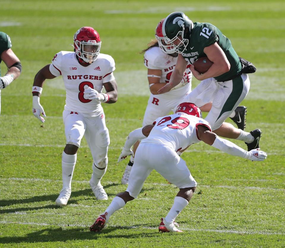 Michigan State quarterback Rocky Lombardi is tackled by Rutgers defensive back Lawrence Stevens during MSU's 38-27 loss on Saturday, Oct. 24, 2020, at Spartan Stadium.