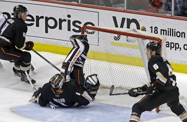 Anaheim Ducks goalie Jonas Hiller (1), of Switzerland, is upended blocking a Minnesota Wild shot in the second period of an NHL hockey game in Anaheim, Calif., Tuesday, Jan. 28, 2014. (AP Photo/Reed Saxon)