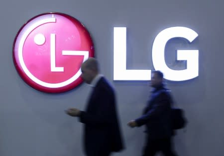 Visitors pass an LG logo at the Mobile World Congress in Barcelona