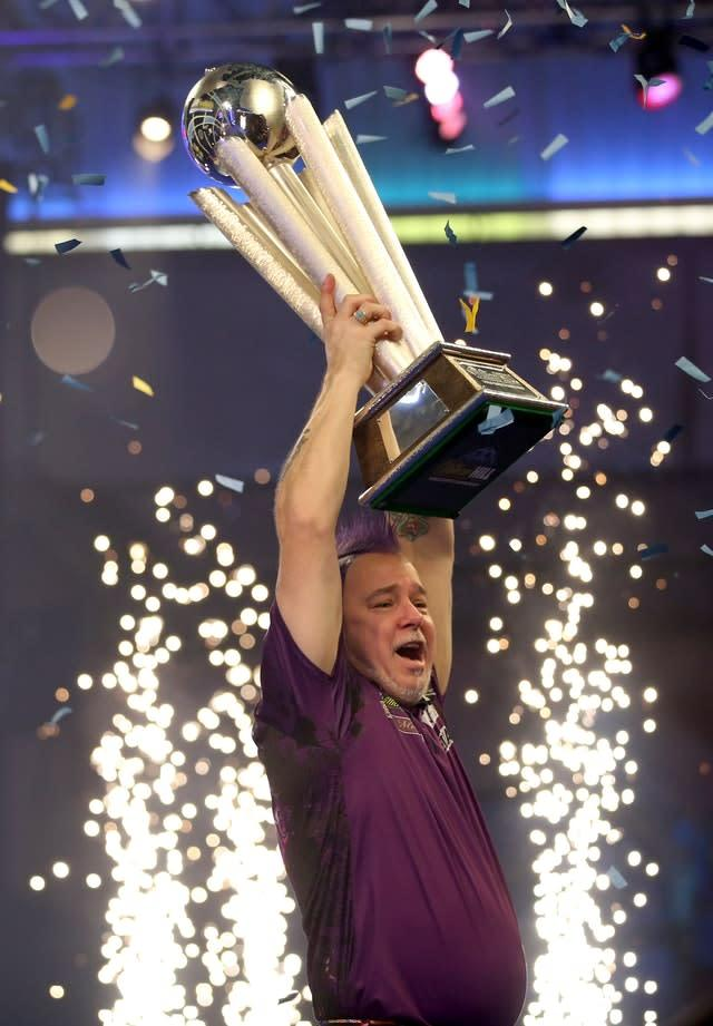 Peter Wright lifts the Sid Waddell Trophy (Steven Paston/PA)