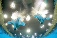 LONDON, ENGLAND - JULY 30: Oleksandr Bondar and Oleksandr Gorshkovozov of Ukraine compete in the Men's Synchronised 10m Platform Diving on Day 3 of the London 2012 Olympic Games at the Aquatics Centre on July 30, 2012 in London, England. (Photo by Adam Pretty/Getty Images)