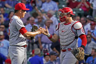 St. Louis Cardinals relief pitcher Giovanny Gallegos, left, celebrates with catcher Andrew Knizner after they defeated the Chicago Cubs in the first baseball game of a doubleheader in Chicago, Friday, Sept. 24, 2021. (AP Photo/Nam Y. Huh)