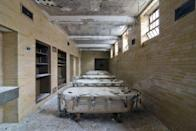<p>A row of hydrotherapy tubs sit side by side - canvas enclosures still intact.</p>
