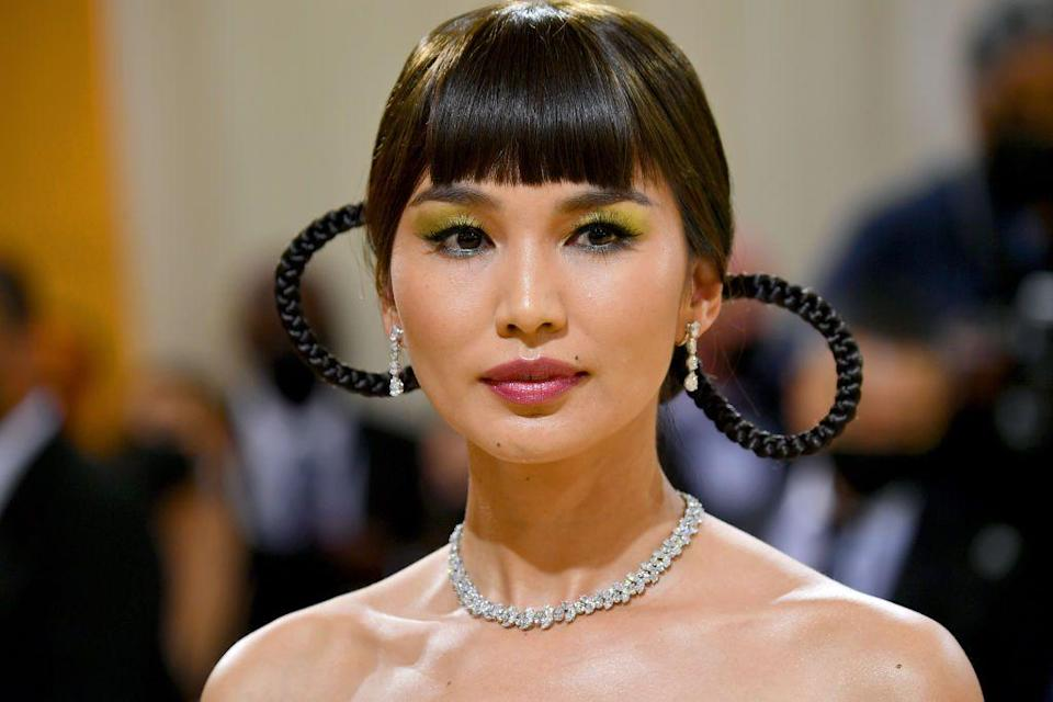 <p>Inspired by Chinese-American actress Anna May Wong, Gemma Chan wowed with zesty bright eye make-up by artist Daniel Martin, and blunt bangs flanking sculptural braids courtesy of stylist Owen Gould.</p>