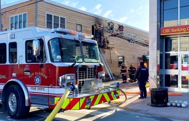 Fire crews battle a blaze at a business and residential complex on Provost Street in New Glasgow on Sunday. (New Glasgow Regional Police - image credit)
