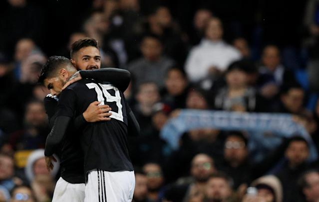 Soccer Football - International Friendly - Italy vs Argentina - Etihad Stadium, Manchester, Britain - March 23, 2018 Argentina's Manuel Lanzini celebrates scoring their second goal with Ever Banega REUTERS/Phil Noble