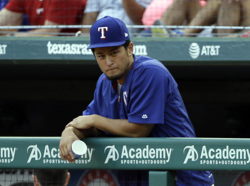 Texas Rangers' Yu Darvish, of Japan, leans on the dugout rail during the first inning of a baseball game against the Baltimore Orioles, Friday, July 28, 2017, in Arlington, Texas.