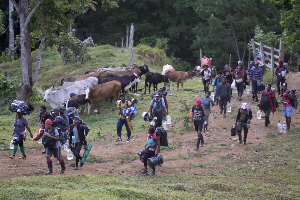 Haitian migrants continue their trek north, in Acandi, Colombia, Wednesday, Sept. 15, 2021. The migrants, following a well-beaten, multi-nation journey towards the U.S., will continue their journey through the jungle known as the Darien Gap. (AP Photo/Fernando Vergara)