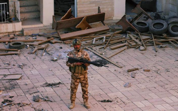 A Christian peshmerga fighter stands in a desecrated church in Batnay in Northern Iraq. (Photo: Ash Gallagher for Yahoo News)