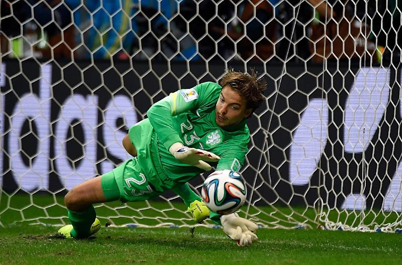 Netherlands' goalkeeper Tim Krul saves a penalty during the shoot-out in the World Cup quarter-final against Costa Rica in Salvador, on July 5, 2014