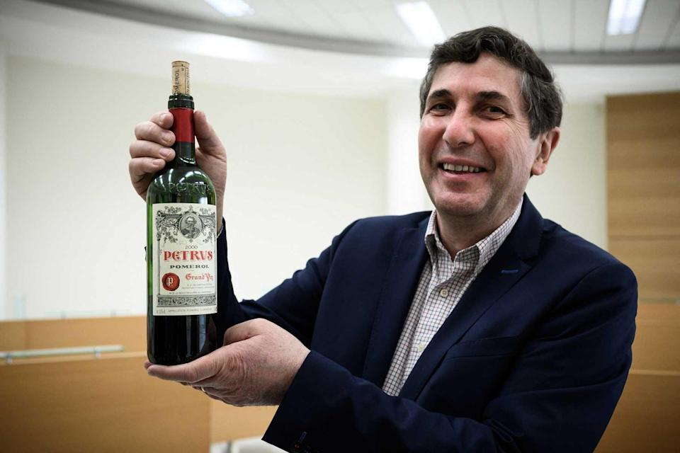 Philippe Darriet, Director of the Oenology Research Unit Institute of Vines, Science and Wine (ISVV) holds a bottle of Petrus, at the University of Bordeaux Institut des Sciences de la Vigne et du Vin (Institute of Vine & Wine Science) in Villenave-d'Ornon, on the outskirts of Bordeaux, southwestern France, on March 1, 2021.