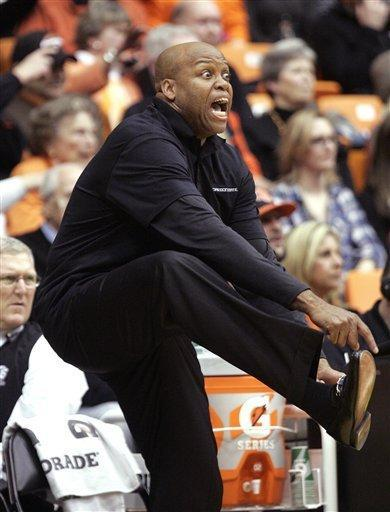 Oregon State coach Craig Robinson calls for a kicked ball during the first half of an NCAA college basketball game against Southern California in Corvallis, Ore., Saturday, Jan. 21, 2012. (AP Photo/Don Ryan)