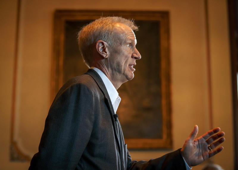 FILE - In this Feb. 23, 2017 file photo, Illinois Gov. Bruce Rauner speaks at a news conference in Springfield, Ill. Gov. Rauner's office filed paperwork Friday, March 10, 2017, to ensure that his new deputy governor Leslie Munger isn't paid from an insurance fund that is $4 billion behind on medical payments. The state comptroller received a letter Friday morning from Rauner's fiscal officer. It requests a portion of Leslie Munger's $138,000 salary come from a professional services fund. (Justin L. Fowler/The State Journal-Register via AP, File)