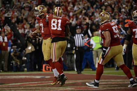 San Francisco, CA, USA; San Francisco 49ers quarterback Colin Kaepernick (7) celebrates after scoring a touchdown against the Atlanta Falcons during the fourth quarter in the final regular season game at Candlestick Park. The 49ers defeated the Falcons 34-24. Kyle Terada-USA TODAY Sports
