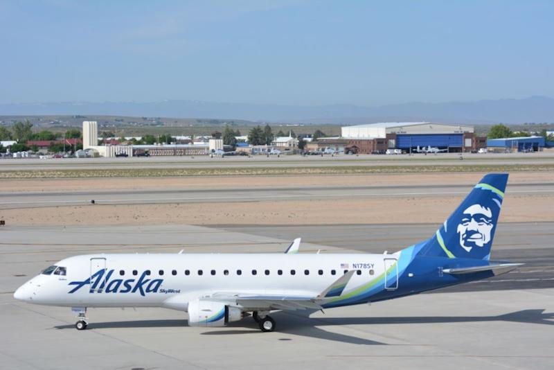 An Alaska Airlines regional jet parked on the tarmac