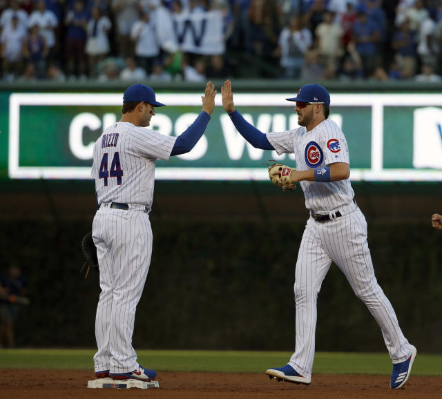 Chicago Cubs' Anthony Rizzo, left, celebrates with teammate Kris Bryant, right, after beating the Cincinnati Reds in a baseball game in Chicago, on Saturday, Sept. 15, 2018. The Cubs won the game 1-0. (AP Photo/Jeff Haynes)