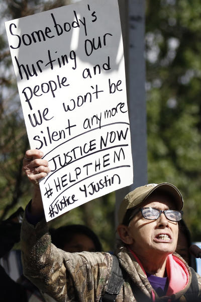 Ann Adams, calls attention to the plight of her incarcerated son, who she alleges does not receive the proper food to accompany his medication, at a mass gathering in front of the Mississippi Capitol in Jackson, on Friday, Jan. 24, 2020, protesting alleged unsanitary and dangerous conditions in prisons where inmates have been killed in violent clashes in recent weeks. (AP Photo/Rogelio V. Solis)