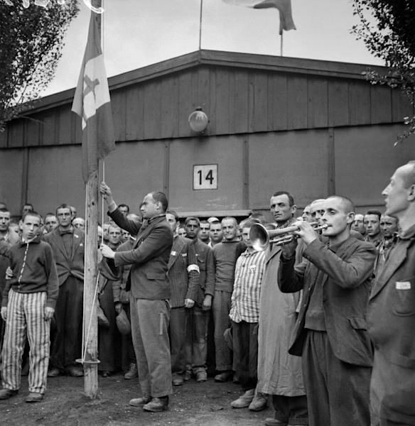 "A picture taken in late April or early May 1945 shows French prisoners singing the national anthem, ""La Marseillaise"", after the camp was liberated by the US army on April 29, 1945 (AFP Photo/Eric Schwab)"