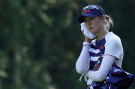 Nelly Korda, of the United States, refreshes on 14th hole during the second round of the women's golf event at the 2020 Summer Olympics, Thursday, Aug. 5, 2021, at the Kasumigaseki Country Club in Kawagoe, Japan. (AP Photo/Matt York)