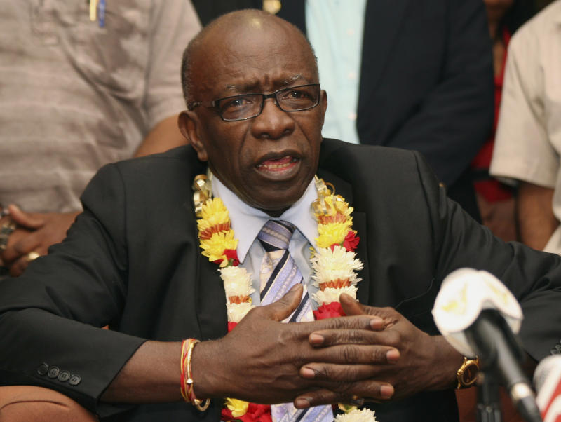 FILE - In this June 2, 2011 file photo, Jack Warner gestures during a news conference held shortly after his arrival at the airport in Port-of-Spain, in Trinidad and Tobago.  Warner, currently the National Security Minister, has forbidden police to release crime reports and statistics, saying that such information encourages people to commit more crime. (AP Photo/Shirley Bahadur, File)