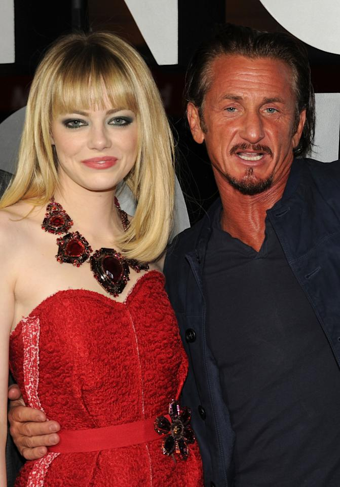 "HOLLYWOOD, CA - JANUARY 07:  Actors Emma Stone and Sean Penn arrive at Warner Bros. Pictures' ""Gangster Squad"" premiere at Grauman's Chinese Theatre on January 7, 2013 in Hollywood, California.  (Photo by Kevin Winter/Getty Images)"