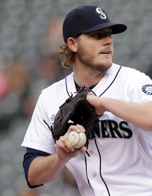 Seattle Mariners starting pitcher Brandon Maurer prepares for a delivery against the Los Angeles Angels in the first inning of a baseball game Thursday, May 29, 2014, in Seattle. (AP Photo/Elaine Thompson)