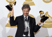 """FILE - Chick Corea poses in the press room with the awards for best improvised jazz solo for """"Fingerprints"""" and best jazz instrumental album for """"Trilogy"""" at the 57th annual Grammy Awards on Feb. 8, 2015, in Los Angeles. Corea, a towering jazz pianist with a staggering 23 Grammy awards who pushed the boundaries of the genre and worked alongside Miles Davis and Herbie Hancock, has died. He was 79. Corea died Tuesday, Feb. 9, 2021, of a rare for of cancer, his team posted on his web site. His death was confirmed by Corea's web and marketing manager, Dan Muse. (Photo by Chris Pizzello/Invision/AP, File)"""
