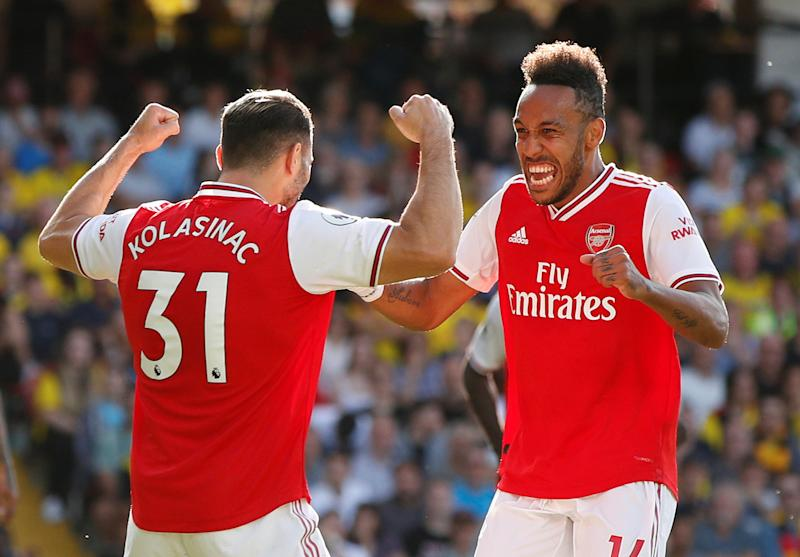 "Soccer Football - Premier League - Watford v Arsenal - Vicarage Road, Watford, Britain - September 15, 2019 Arsenal's Pierre-Emerick Aubameyang celebrates scoring their first goal with Sead Kolasinac Action Images via Reuters/John Sibley EDITORIAL USE ONLY. No use with unauthorized audio, video, data, fixture lists, club/league logos or ""live"" services. Online in-match use limited to 75 images, no video emulation. No use in betting, games or single club/league/player publications. Please contact your account representative for further details."