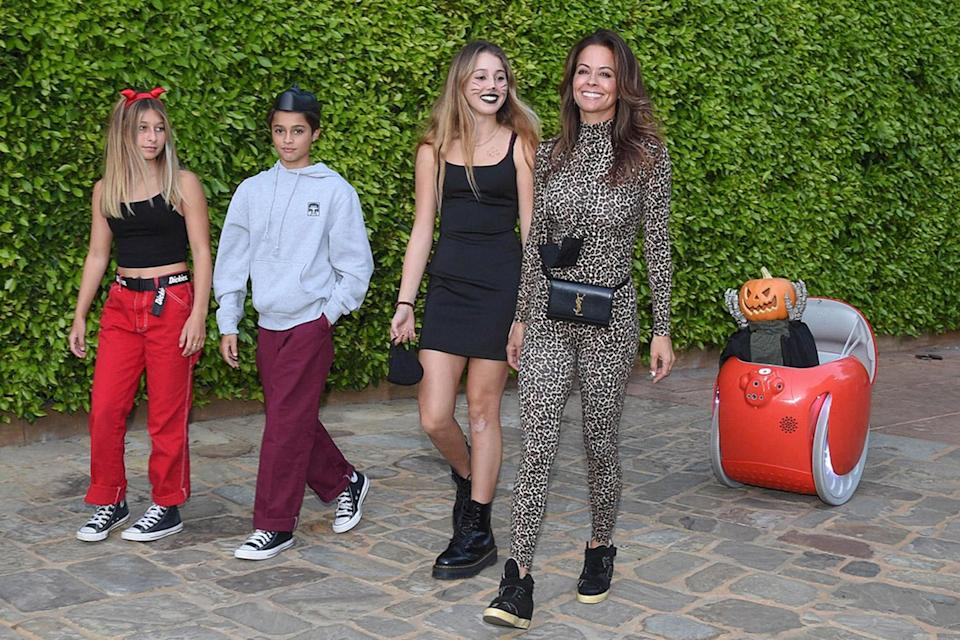 <p>Brooke Burke, son Shaya, daughter Heaven Rain and their friend got an early start on Halloween on Friday, ensuring they could trick or treat contact-free by using the gita robot to do the heavy candy lifting.</p>