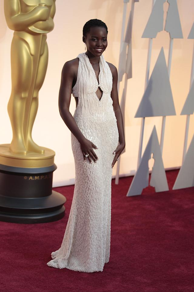 <p>Acting star Lupita Nyong'o dominated the 2015 Oscars in a Calvin Klein gown formed of over 6000 pearls. The one-of-a-kind design is said to have cost around $150,000 (£115,000) to create.<br /><i>[Photo: Getty]</i> </p>
