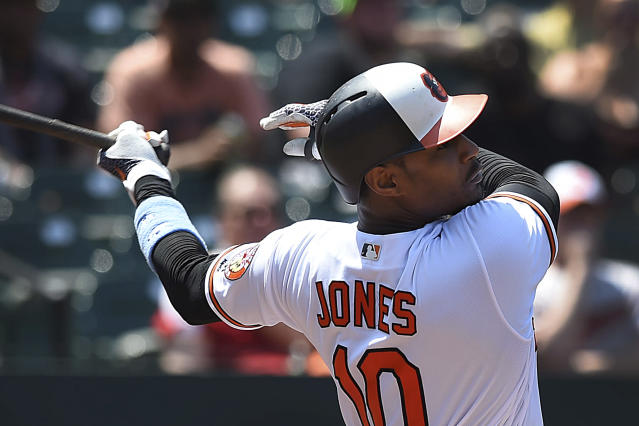Baltimore Orioles' Adam Jones hits a two-run double against the Miami Marlins in the fourth inning of baseball game, Sunday, June 17, 2018, in Baltimore. (AP Photo/Gail Burton)