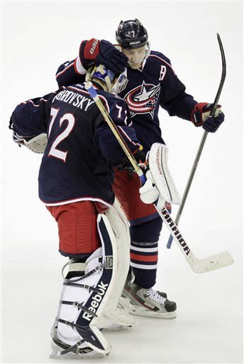 Columbus Blue Jackets' Jack Johnson, right, congratulates Sergei Bobrovsky, of Russia, after their 2-1 overtime win against the Anaheim Ducks in an NHL hockey game, Sunday, March 31, 2013, in Columbus, Ohio. (AP Photo/Jay LaPrete)