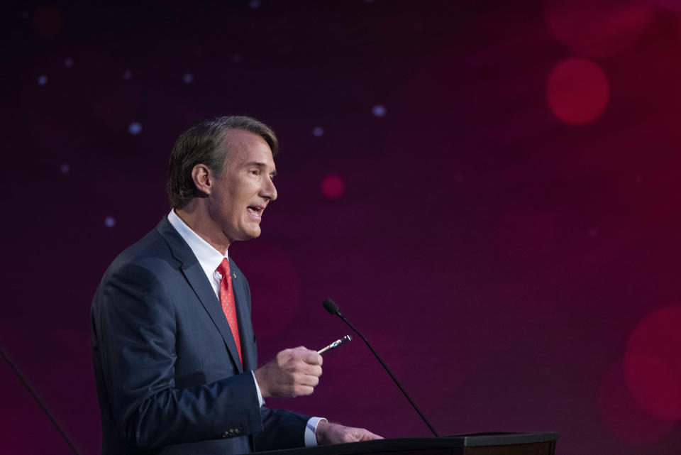 Virginia Republican gubernatorial candidate Glenn Youngkin participates in a debate with Democratic gubernatorial candidate and former Gov. Terry McAuliffe at Northern Virginia Community College, in Alexandria, Va., Tuesday, Sept. 28, 2021. (AP Photo/Cliff Owen)