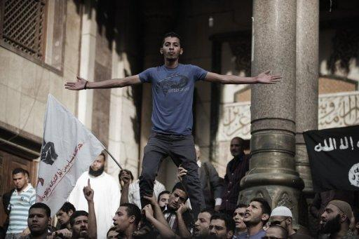 Hundreds of anti-military demonstrators shout slogans outside a mosque in downtown Cairo ahead of a march to the Abbassiya district, May 2. Campaigning for Egypt's first post-uprising presidential poll was temporarily on hold after thugs attacked an anti-military protest near the defence ministry in Cairo, leaving 20 people dead