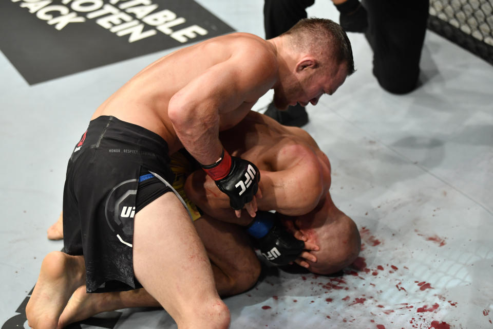 ABU DHABI, UNITED ARAB EMIRATES - JULY 12: (L-R) Petr Yan of Russia punches Jose Aldo of Brazil in their UFC bantamweight championship fight during the UFC 251 event at Flash Forum on UFC Fight Island on July 12, 2020 on Yas Island, Abu Dhabi, United Arab Emirates. (Photo by Jeff Bottari/Zuffa LLC)