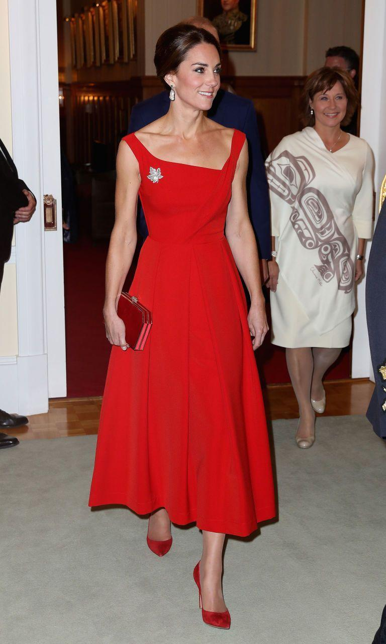 <p>Duchess Kate's Preen by Thornton Bregazzi red dress was glamorous for an evening reception at the Government House in Victoria. She styled the the British design duo's asymmetric neckline and full skirt with her hair in a low chignon and pearl earrings from Soru.</p>