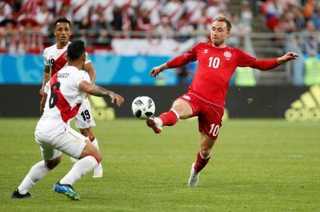 Soccer Football - World Cup - Group C - Peru vs Denmark - Mordovia Arena, Saransk, Russia - June 16, 2018 Denmark's Christian Eriksen in action with Peru's Miguel Trauco REUTERS/Max Rossi